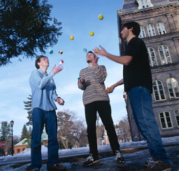 Three students juggling