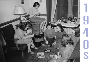 A Vassar Dorm Room From 1940s. Several Girls Sit On The Fllor, Sharing Ritz Part 54