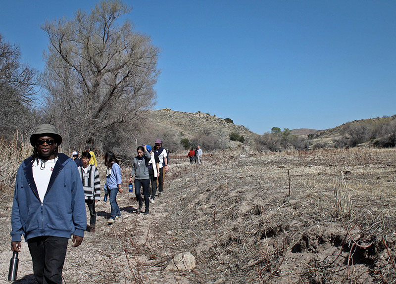 Professor Tyrone Simpson and students leave water along migrant trails