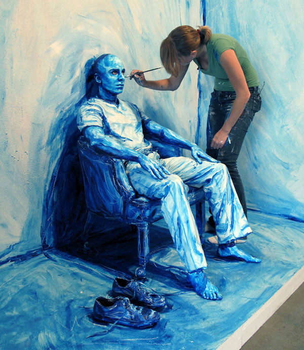"""Using modified acrylic paint, Meade then paints directly onto the skin of her models. """"Blueprint Installation."""""""