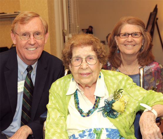 Mary Virginia Steck Kern '34 celebrates her 100th birthday with son Tom and daughter Anne.