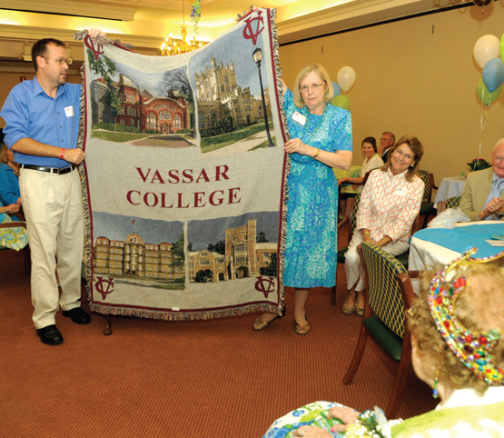 Stern receives a Vassar blanket, a present from the college.