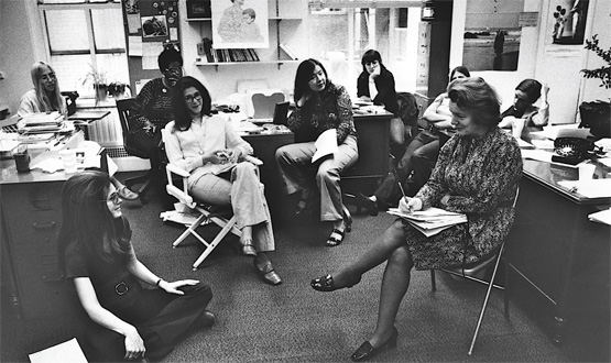 Gloria Steinem, seated on floor, in a meeting with early Ms. staffers, June 1972.