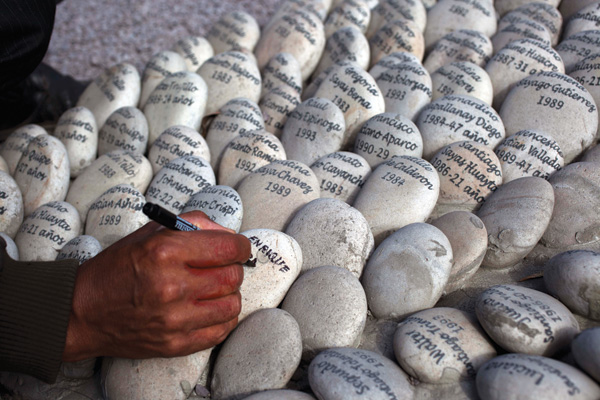 As a way to remember those who disappeared during the nation's 20-year civil conflict, family members write the victims' names on rocks.