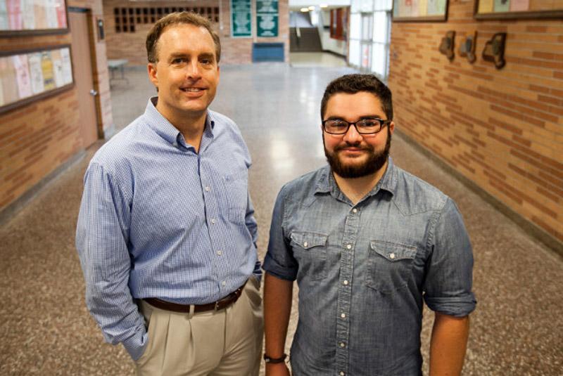 Education professor Chris Bjork and Ford Scholar Kyle DeAngelis '15.