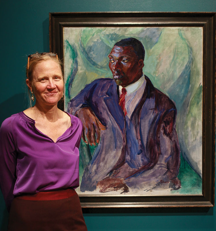 Curator Barbara Paca with Rose's Suited Man